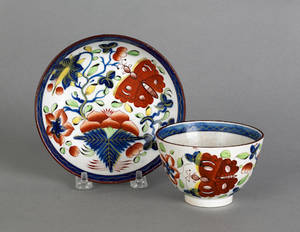 Gaudy Dutch butterfly cup and saucer 19th c