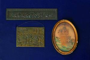 Two Continental brass plaques