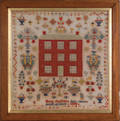 Wool on linen pictorial sampler with a Georgian house