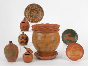 Eight pieces of contemporary Shooner redware