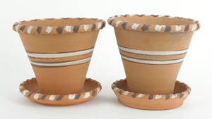Two IS Stahl redware flower pots and undertrays