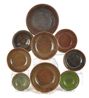 Nine Stahl redware bowls dated from 19311952