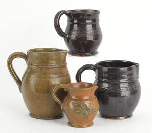 Four Stahl redware pitchers 19th c