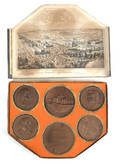 Boxed set of six Philadelphia Exposition wooden medals