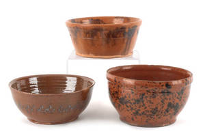Three Pennsylvania redware bowls 19th c