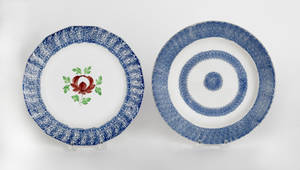 Two blue spatter plates with Adams Rose and bullseye 19th c