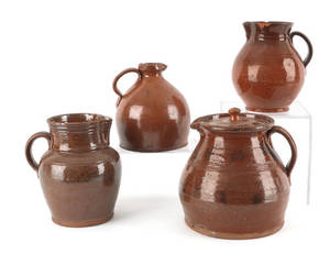 Three Pennsylvania redware pitchers 19th c