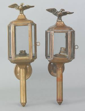 Two brass lanterns with eagle finials