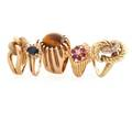 Five yellow gold rings most with gemstones