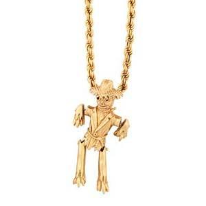 Yellow gold scarecrow pendant on chain