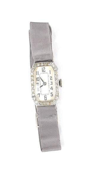 Ladies Swiss wrist watch with platinum case and gray ribbon band