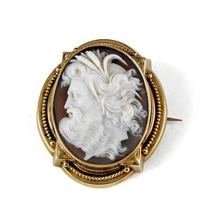 14K yellow gold cameo brooch with an ornate frame shell cameo of a god with wavy hair