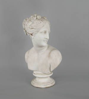 Carved white marble bust of a woman late 19th c
