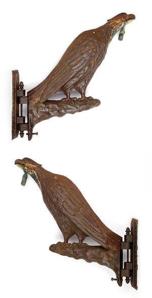 Pair of cast iron eagle form brackets 19th c