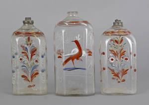 Three Stiegel type enameled glass bottles early 19th c