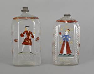 Two Stiegel type enameled glass bottles early 19th c