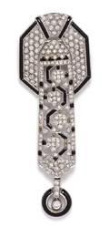 An 18 Karat White Gold Diamond and Onyx Pendant Brooch