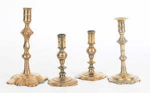 Four Queen Anne brass and bellmetal candlesticks mid 18th c