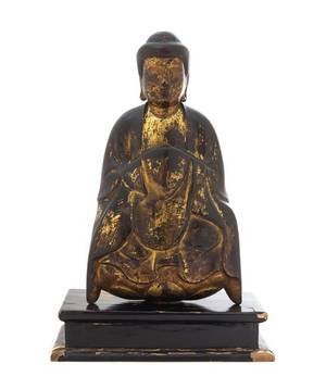 A Gilt and Black Lacquered Wood Figure of a Seated