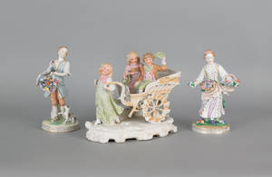 Pair of Dresden porcelain figures of a man and woman