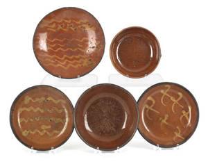 Five Pennsylvania redware plates 19th c