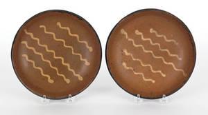 Pair of Pennsylvania redware pie plates 19th c
