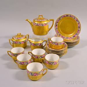 Twentyone Piece Gilt and Floraldecorated Porcelain Tea Set