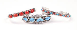 Three sterling silver cuffs with turquoise and coral insets