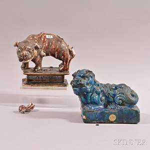 Two Glazed Pottery Figures of Mythical Animals