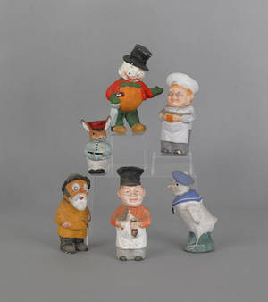 Six composition figural candy containers