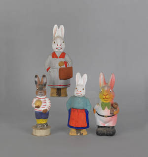 Four composition figural rabbit candy containers