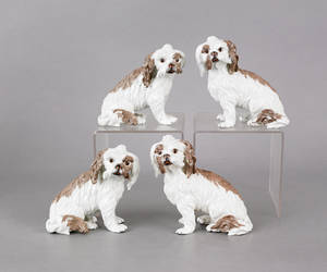 Set of four French porcelain dogs with underglaze crossed swords marked with an  S