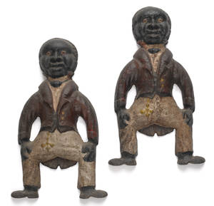 Pair of cast iron figural andirons late 19thearly 20th c