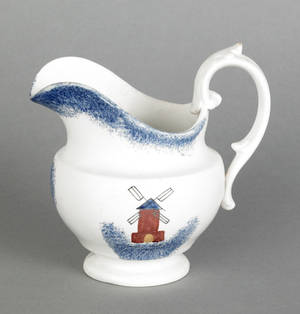 Blue spatter creamer with a windmill