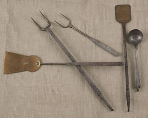 Collection of Pennsylvania wrought iron and brass kitchen utensils