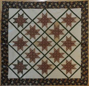 Pieced star in diamond quilt ca 1840