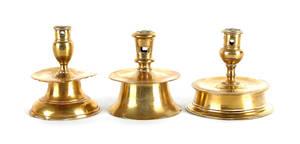 Three brass capstan candlesticks 17th c