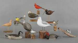 Eight carved and painted birds by Peter Peltz