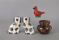 Pair of Staffordshire spaniels together with a pottery bird whistle and a cow canister