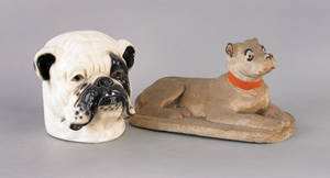 Sewer tile figure of a recumbent dog