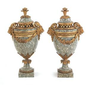 Pair of French ormolu mounted marble urns with rams head handles