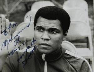 MUHAMMAD ALI SIGNED AND INSCRIBED PHOTOGRAPH