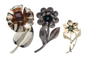 A Collection of Sterling Silver Gemstone and Glass Flower Motif Brooches