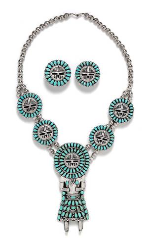 A Sterling Silver and Turquoise Sunface Kachina Doll Motif Demi Parure Larry Moses Begay Navajo