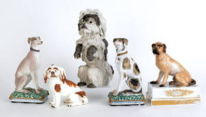 Five Continental porcelain dogs late 19thearly 20th c