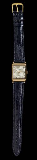 A 14 Karat Yellow Gold Chronometer Wristwatch Ulysse Nardin