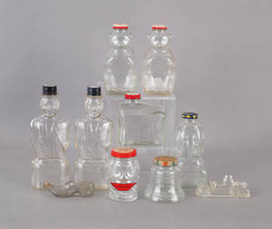 Collection of glass banks and ink bottles