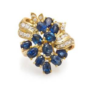 A 14 Karat Yellow Gold Sapphire and Diamond Spray Ring