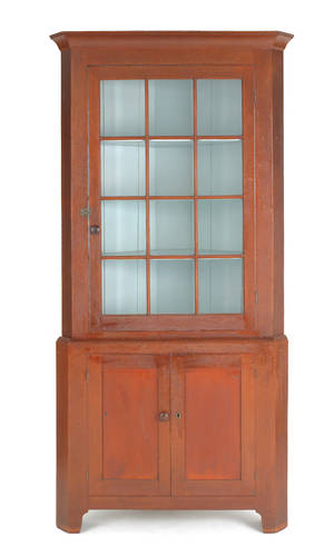 Pennsylvania stained cherry corner cupboard early 19th c