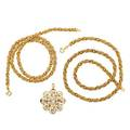 Two gold rope necklaces  diamond scroll brooch